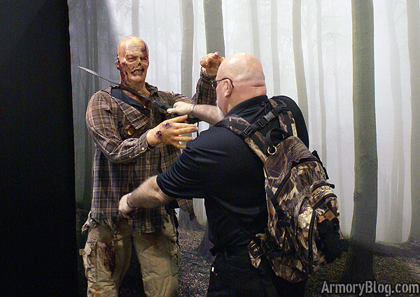 shot-show-2012-the-walking-dead-gerber-booth-zombie-killing