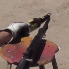 Opening a Beer With a Rifle